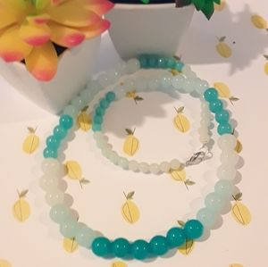 Graduated ombre teal bead necklace